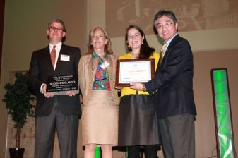 Representatives from Lynch's Landing Foundation and the city of Lynchburg accept awards for over 90,000 volunteer hours dedicated to downtown revitalization and over $100 million of private investment in Lynchburg's historic commerical district since 2000. The awards were presented by Secretary of Commerce and Trade Jim Cheng and VMS Program Manager Jeff Sadler.