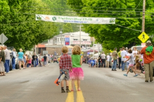 Two kids stand in the middle of Main Street, their water guns ready, waiting for the start of the Hiker Parade during Trail Days, an annual celebration for past, current, and future Appalachian Trail thru-hikers featuring music, vendors, gear repair, trail information, and the infamous hiker parade, held in Damascus, VA on Saturday, May 18, 2013. Copyright 2013 Jason Barnette